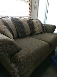Couch and love seat with pillows