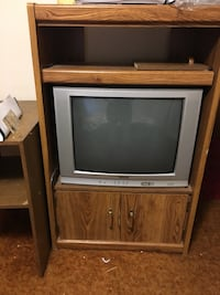 gray CRT television with brown wooden TV stand Calgary, T3B 2T3
