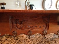 Vintage carved oak shelf unit with brass coat hooks. Paid 325.00 yours for $115.00 Frederick, 21701