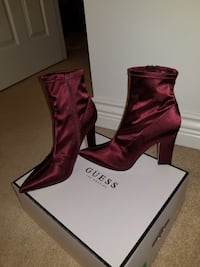 pair of maroon Guess suede heeled booties with box Surrey