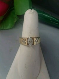 gold-colored ring with clear gemstones Houston, 77037