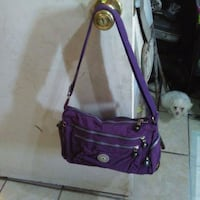 purple and black leather crossbody bag Bakersfield, 93307