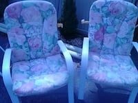 white gray and pink floral padded armchair