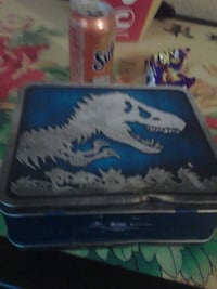 blue and gray dinosaur-printed steel case