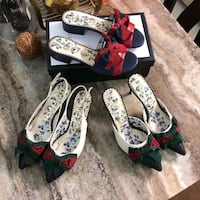 three pairs of white-and-green floral heeled sanda Toronto