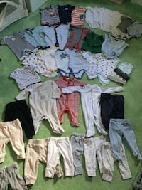 baby's assorted-color clothes lot null