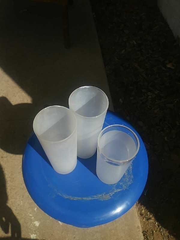 three frosted drinking glass