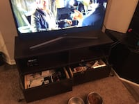 black wooden TV stand with flat screen television Naperville, 60563