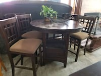 brown high top table with leaf and chairs