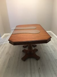 Brown wooden dining room table with leaf 5 chairs