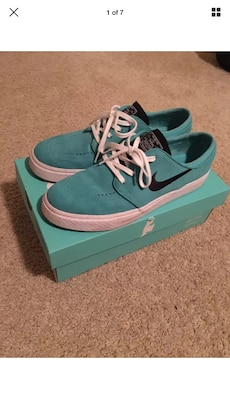 pair of green low top sneaker with box