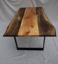 "walnut dining table with a maple centre. Black steel legs 6ft x 40 "" Strathroy-Caradoc, N7G 1H1"