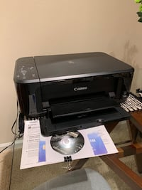 black and gray Canon desktop printer 11 km