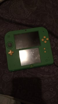 Green nintendo ds with game cartridge 1484 mi