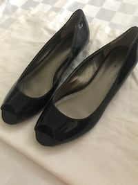 pair of black leather pointed-toe heeled shoes New York, 10036