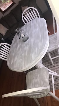 white and grey table with 4 chairs  null