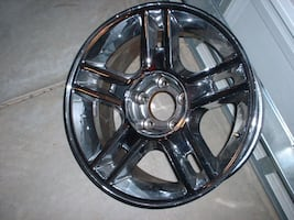 One 20 inch chrome wheel.