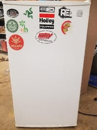 KENMORE SMALL REFRIGERATOR WHITE - WITH STICKERS ON IT. 73107