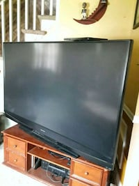 black flat screen TV with remote Baltimore, 21225