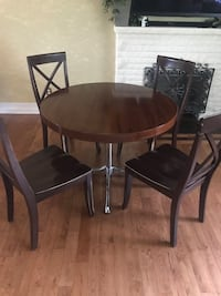 Round wood  table with 4 chairs