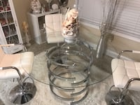 """Brand New Chrome and Glass Dining Table. 47.25"""" Diameter and 30"""" Tall. Three Brand New white Bar stools, adjustable. Jefferson, 30549"""