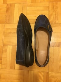 pair of black leather flat sandals