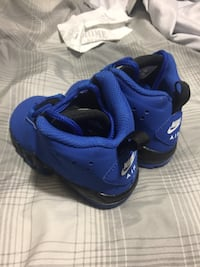 toddler's blue and black Nike Air 41 mi