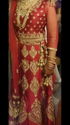 red and gold lehenga choli