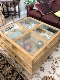 brown wooden framed glass top coffee table Deland, 32724