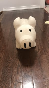 white ceramic pig figurine 610 km