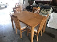 Solid wood table four matching chairs  Edmonton, T5M 0S6