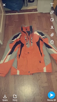 orange och grå zip-up jacka