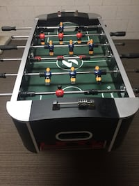 Black and green foosball table (soccer)