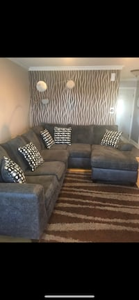 Sectional with swivel chair