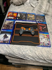 black Sony PS4 with game cases Grand Terrace, 92313