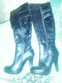 pair of black leather knee high boots Las Vegas, 89101