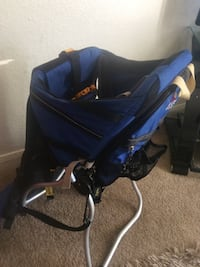 baby's blue, black, and gray backpack carrier