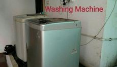 two silver and white top load washing machines