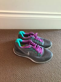 pair of gray-and-teal Nike running shoes Vancouver, V6G 3J1