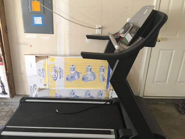 White and black Epic Treadmill. 91fa11a9-9a4d-4e0f-9d07-80d3e094507a