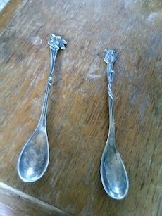 two silver-colored spoons