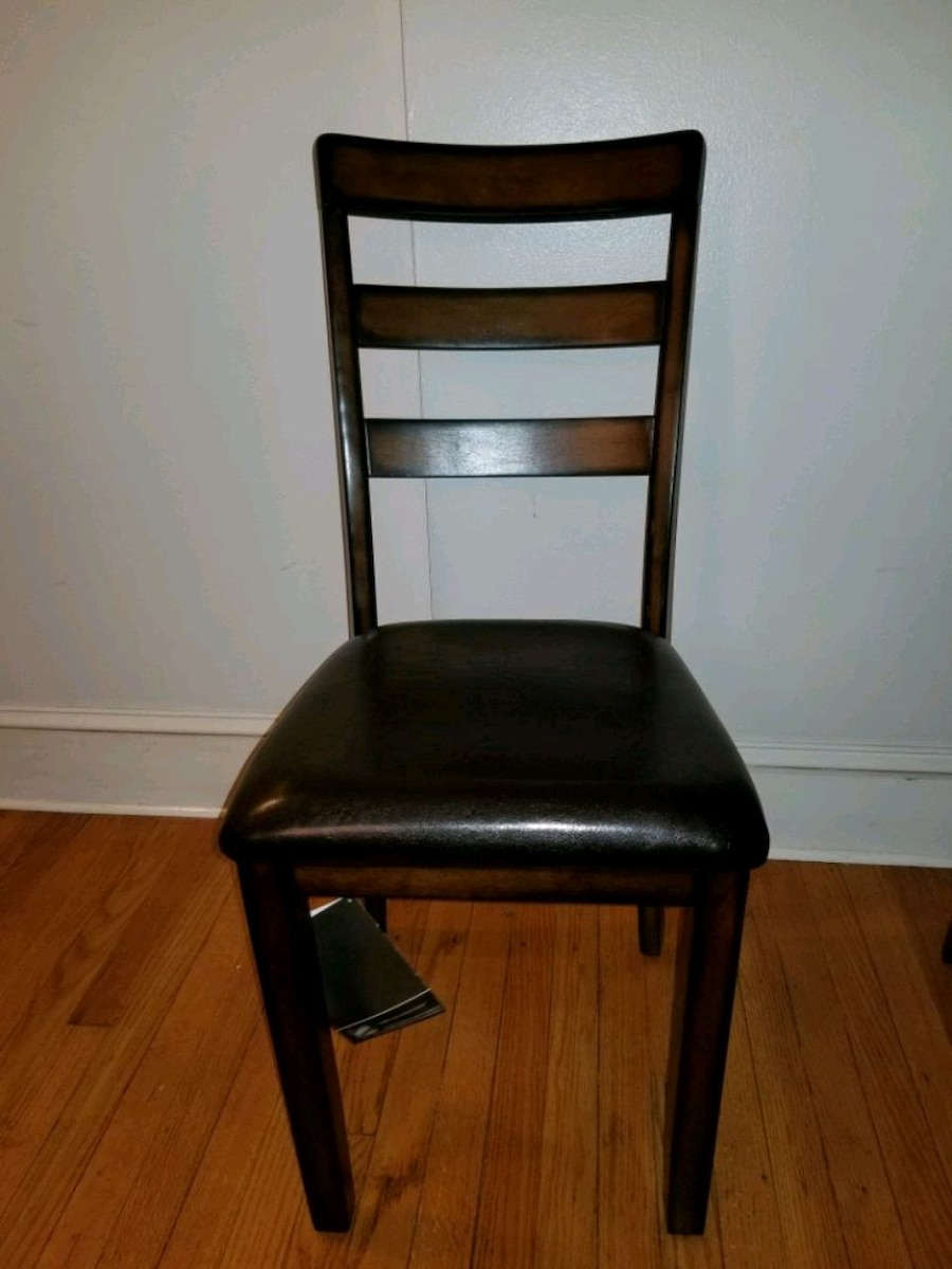 4 BRAND NEW Wooden Chairs By Ashley Furniture