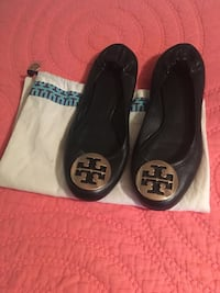 pair of women's black Tory Burch leather ballet flats