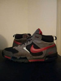 pair of gray-and-red Nike running shoes Conyers