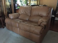 Brown faux leather loveseat