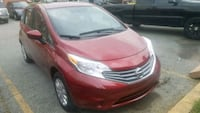 red Nissan 5-door hatchback 27 mi