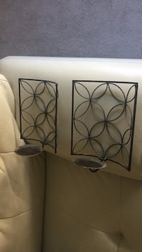 Two brown/bronze wall sconces