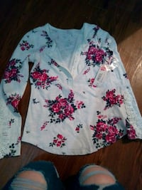 white, pink, and green floral long-sleeved shirt