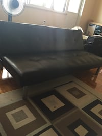 black leather padded sectional sofa