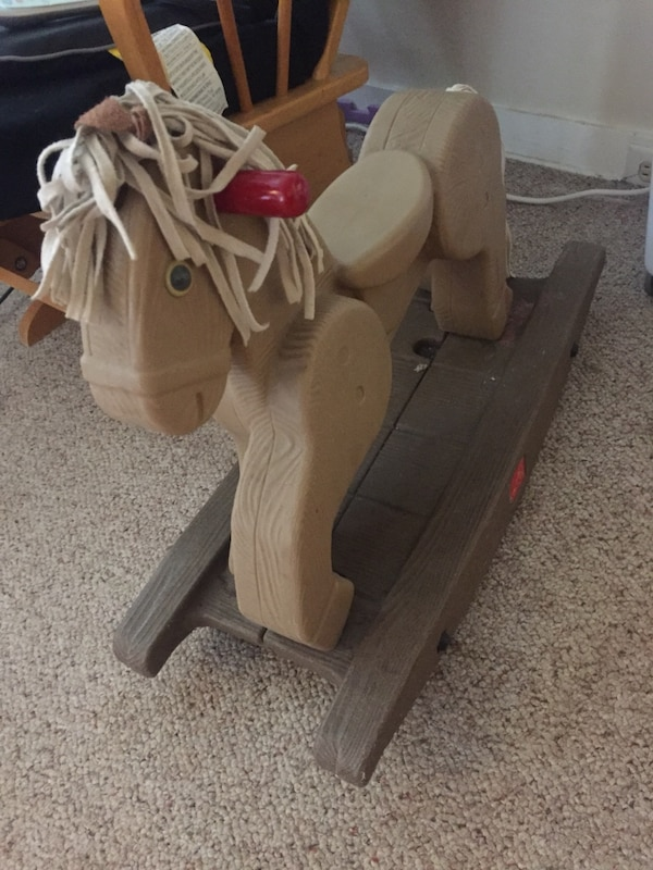 brown wooden ride on rocking horse toy